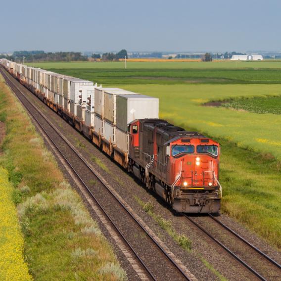 Train going through plains