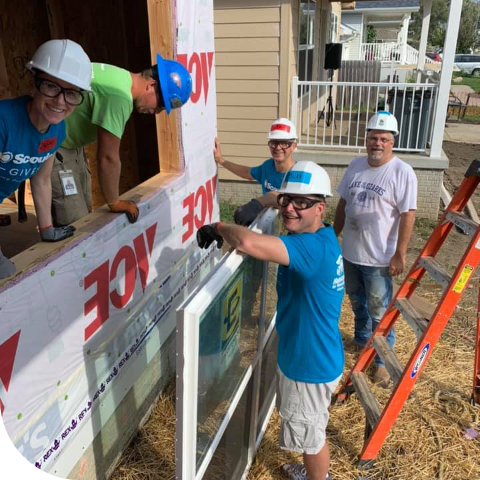 Scoular team working on building house for the community