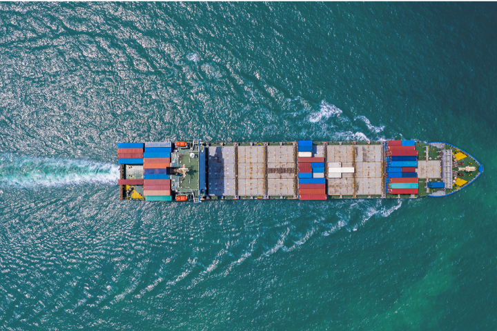 Birdseye-view of large freight ship in ocean